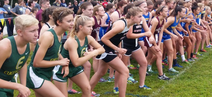 Varsity girls Grace, Leah and Lilly have their game faces on for the start