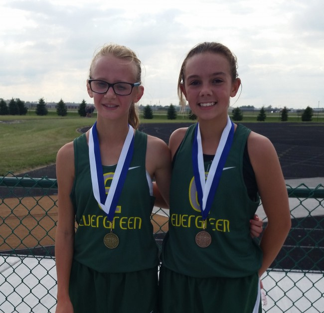Kennedy and Maddy after taking 1st and 3rd in the 7th Grade Girls race