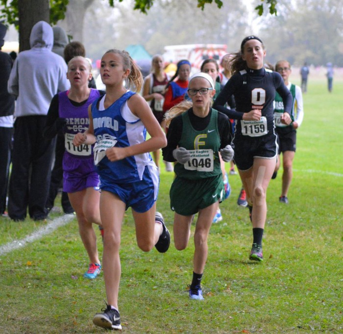 Kennedy keeps pace on the way to a new girls middle school record.