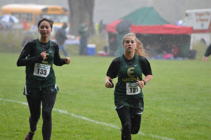 Leah and Lilly, soaked to the bone and nearing the finish