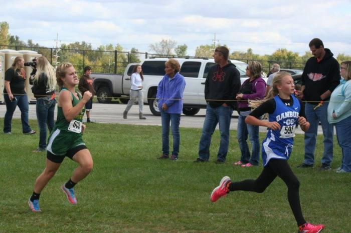 Lilly chases down one last runner on her way to a lifetime PR