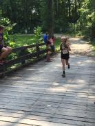 Kennedy crosses the bridge to the final hill