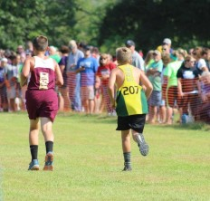 Owen sprints to pass another runner at the end