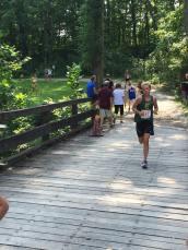 Paige crosses the bridge near the end