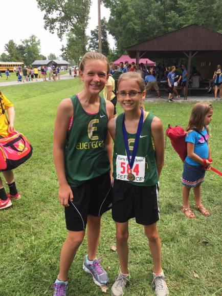 Paige and Kayla celebrate a successful race